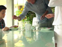 Family preparing and putting plates and cutlery on table at home NTSC Stock Footage