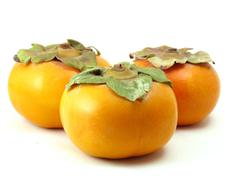 three persimmons - stock photo