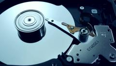 Dolly shot of Hard disk drive with spinning platter Stock Footage