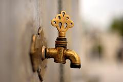 Date of ablution tap made of brass - stock photo