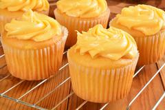 cupcakes on a wire cooling rack - stock photo