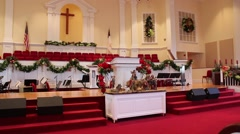 Christmas Decorations and Nativity Scene in Front of Podium Inside Church Stock Footage