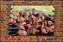 Appetizing barbecue on fire behind the broken wall Stock Photos