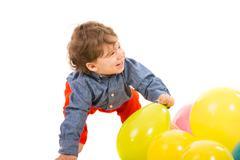 Laughing toddler looking away Stock Photos