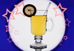 Stock Photo of yellow mulled wine on blue background with stars
