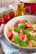 Noodles with asparagus in cream-cheese sauce Stock Photos