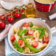 Noodles with asparagus in cream-cheese sauce - stock photo