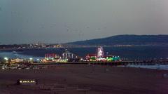 Santa Monica Pier Ferris Wheel Night Lit Up Lights Beach in Los Angeles Stock Footage