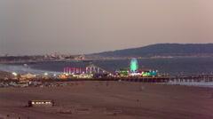Santa Monica Pier Ferris Wheel Night Lit Up Lights Beach Los Angeles California Stock Footage