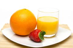 an orange, an strawberry and orange juice - stock photo