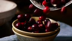 Cranberries pouring into dish, slow motion - stock footage