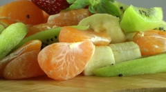 Stock Video Footage of Fruit Salad with Strawberry, Kiwi, Mandarin and Banana