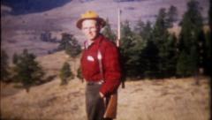 1401 - a deer hunter views the countryside for deer - vintage film home movie Stock Footage