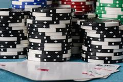 Stacked poker chips with ace card Stock Photos