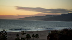 Sunset in Santa Monica on Beach Pacific Ocean Palm Trees Tropical Paradise LA Stock Footage