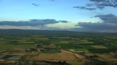 Aerial USA Idaho sunset farming crops vegetation field arable farmland - stock footage