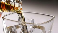 Pouring whisky, slow motion - stock footage