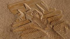 Sand blowing off Egyptian carving & hieroglyphics Stock Footage