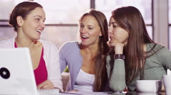 4K Cheerful young female friends relaxing or working together with laptop comput Stock Footage