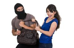 Stock Photo of male thief robbing beautiful young girl