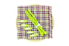 Stock Photo of close up asparagus on table cloth in wooden plate on a white background