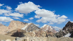 Snowy mountains in clouds. Zoom. Time Lapse. Pamir, Tajikistan. 1280x720 Stock Footage