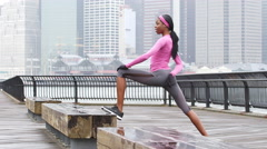 A woman warms up before a run Stock Footage