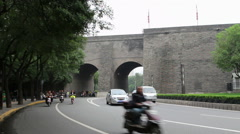 Cars driving through the ancient city gate Stock Footage