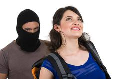 Masked male thief robbing beautiful young girl Stock Photos