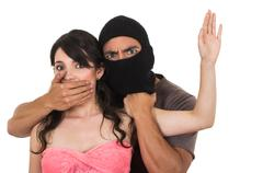 male thief holding young girl - stock photo