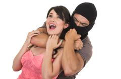 Stock Photo of male thief strangling young girl