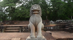 Zoom Out of Restored Guardian Lion Statue - Angkor Wat Temple Complex Cambodia Stock Footage