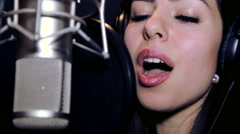 Portrait close up of the singer.Recording in the studio singers. Stock Footage