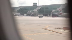 POV Airplane passenger view of airport runway - stock footage