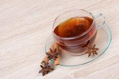 Tea with star anise and cinnamon - stock photo