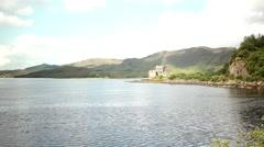 Beautiful castle beside lake, highlands scotland, famous holiday destination Stock Footage