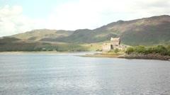 Beautiful castle beside lake, highlands scotland, mountain background Stock Footage