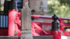 People playing bell in a temple, Tokyo, Japan Stock Footage