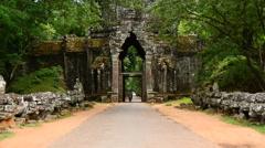 Vehicles Drive through Archway on Bridge - Angkor Wat Cambodia Stock Footage