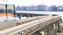 Tokyo monorail train passing by on elevated track, Tokyo, Japan Stock Footage
