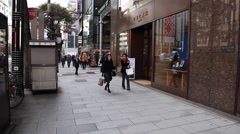 People walking around the Ginza shopping district, Tokyo, Japan Stock Footage