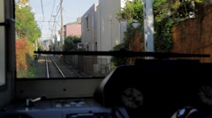 View from the Enoden train front window, Enoshima, Kanagawa Prefecture, Japan Stock Footage