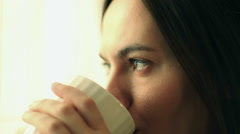 Beautiful girl drinking tea or coffee, close up HD - stock footage