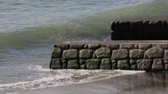 Waves crashing against rocky shore in Inamuragasaki, Kanagawa Prefecture, Japan Stock Footage