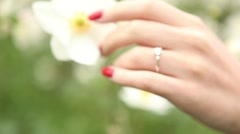Stock Video Footage of Beautiful wedding ring, proposal ring and white flowers