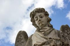 statue of the angel who watches over the dead - stock photo