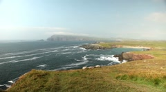 Beautiful bay in Irish landscape. Rough sea on a sunny day - stock footage
