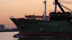 Ship at Tokyo Bay near Haneda airport at sunset, Tokyo, Japan Stock Footage