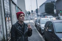 Punk guy posing in the city streets Stock Photos