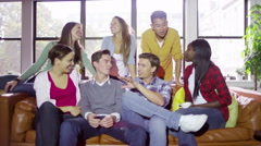 Portrait of cheerful casual group of young friends hanging out together - stock footage